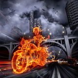 Fire biker. Burning skeleton riding a motorcycle Stock Images