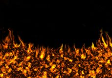 Fire on a black background. Fiery abstract background on a black background Royalty Free Stock Image