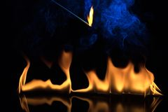 Fire on a black background Stock Photos
