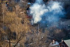 Fire with black smoke in house. House in smoke.  Royalty Free Stock Images