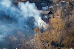 Fire with black smoke in house. House in smoke.  Stock Photo