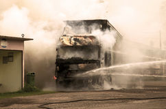 Fire and black smoke on the road after a truck collision Royalty Free Stock Images