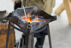 Fire blacksmith forge handmade burnt metal with winding Royalty Free Stock Photos