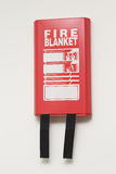 Fire Blanket. A Wall Mounted Fire Blanket