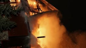 Fire. Blaze Inferno conflagration and combustion. House building on fire at night. Blaze Inferno conflagration and combustion. Vertical format video stock footage
