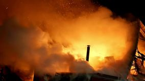 Fire. Blaze Inferno conflagration and combustion. House building on fire at night. Blaze Inferno conflagration and combustion stock footage