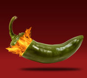 Fire Blowing off Cap of Jalapeno Stock Photos