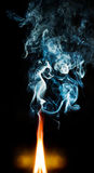 Fire and blue smoke. Abstract background Royalty Free Stock Images