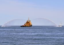 Dancing with Water, Fire Boat Spraying Water royalty free stock image