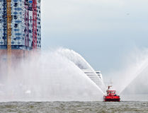 Fire-boat at the concert-hall Elbphilharmonie Stock Image