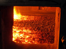 Fire in the boiler furnace grate Royalty Free Stock Photo