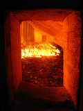 Fire in the boiler grate. Fire and water boiler furnace stoker coal-fired stock photos