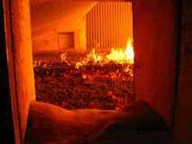 Fire in the boiler grate. Fire and water boiler furnace stoker coal-fired royalty free stock photography