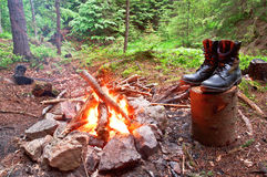 Fire and boots. Evening fire and military (hiking) boots Stock Image