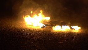 The fire in the bowl. Fire burns in the bowl on the grass at night stock footage