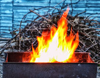 Fire in brazier. Spurts of flame in brazier/barbecue Royalty Free Stock Image