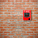Fire break glass alarm switch on brick wall background Royalty Free Stock Photos