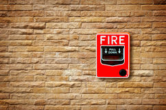 The fire break glass alarm switch on the wall Stock Images