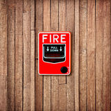 Fire break glass switch on  Wooden wall background Stock Photos