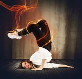 Fire breakdancer. Agile breakdancer girl surrounded by fire effect stock photos