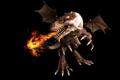Fire breathing dragon. On a black background. Room for text or copy space Royalty Free Stock Photography