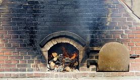 Fire in a brick-built baking oven Stock Image