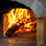 Fire in brick oven. Blaze of fire in the traditional brick oven for baking Stock Photos