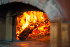 Fire in brick oven. Blaze of fire in the traditional brick oven for baking Royalty Free Stock Image