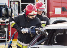 Fire Brigade in action at car accident Stock Photography