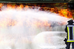 Fire brigade extinguishes a big fire Royalty Free Stock Photography
