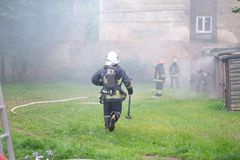Fire brigade extinguishes fire Royalty Free Stock Photography