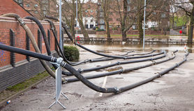 Fire Brigade Hose Pipes. Fire brigade hosepipes being used to pump flood water out of flooded buildings Royalty Free Stock Image