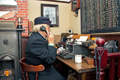 Fire brigade Ops room. HEADCORN, UK - AUGUST 17: A female reenactor in WW2 Fire Brigade uniform answers an emergency call during a re-enactment of the Blitz at Royalty Free Stock Image