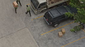 Fire Brigade Training Men Carry Boxes to Parking stock video