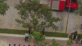Fire Brigade Training Men Form in Column at Firecar with Ladder. NHA TRANG, KHANH HOA/VIETNAM - MAY 28 2016: Upper view practical training of fire brigade men in stock footage
