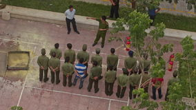 Fire Brigade Training Men Form in Column near Extinguishers. NHA TRANG, KHANH HOA/VIETNAM - MAY 28 2016: Upper view practical training of fire brigade men in stock footage