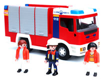 Fire brigade. Fire truck and fir brigade (Playmobil toys Royalty Free Stock Photo