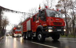 Fire brigade trucks. Wednesday, December 1, 2010: Fire brigade trucks in formation at a military parade on Romania's national Day, December 1, in Bucharest Royalty Free Stock Photos