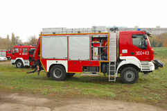 Fire brigade trucks during exercises on river bank Royalty Free Stock Photography