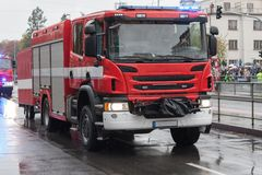 Fire brigade workers are riding fire truck on military parade