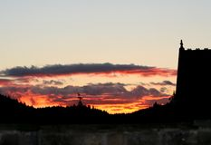 Fire and Brimestone. Sun sets over Rural Chapel and forest Stock Photography