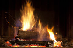 Fire and brimstone. Wood logs burning in a fireplace Royalty Free Stock Photo
