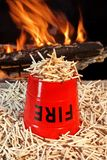 Fire bucket, matches and Flames Royalty Free Stock Photography
