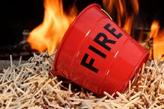 Fire bucket, matches and Flames Stock Image