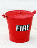 Fire bucket. An old retro fire bucket against a high key background Royalty Free Stock Photo