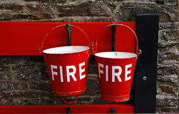 Fire buckets. Red fire buckets at an old railway station stock photography