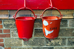 Fire buckets. A collection of three fire buckets at a steam railway station Royalty Free Stock Photos