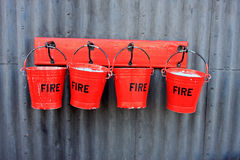 Fire buckets. Hanging on wall Stock Images