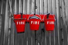 Fire Buckets. Three bright red fire buckets Royalty Free Stock Photography