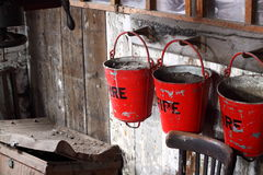 Fire buckets on wall Stock Photos